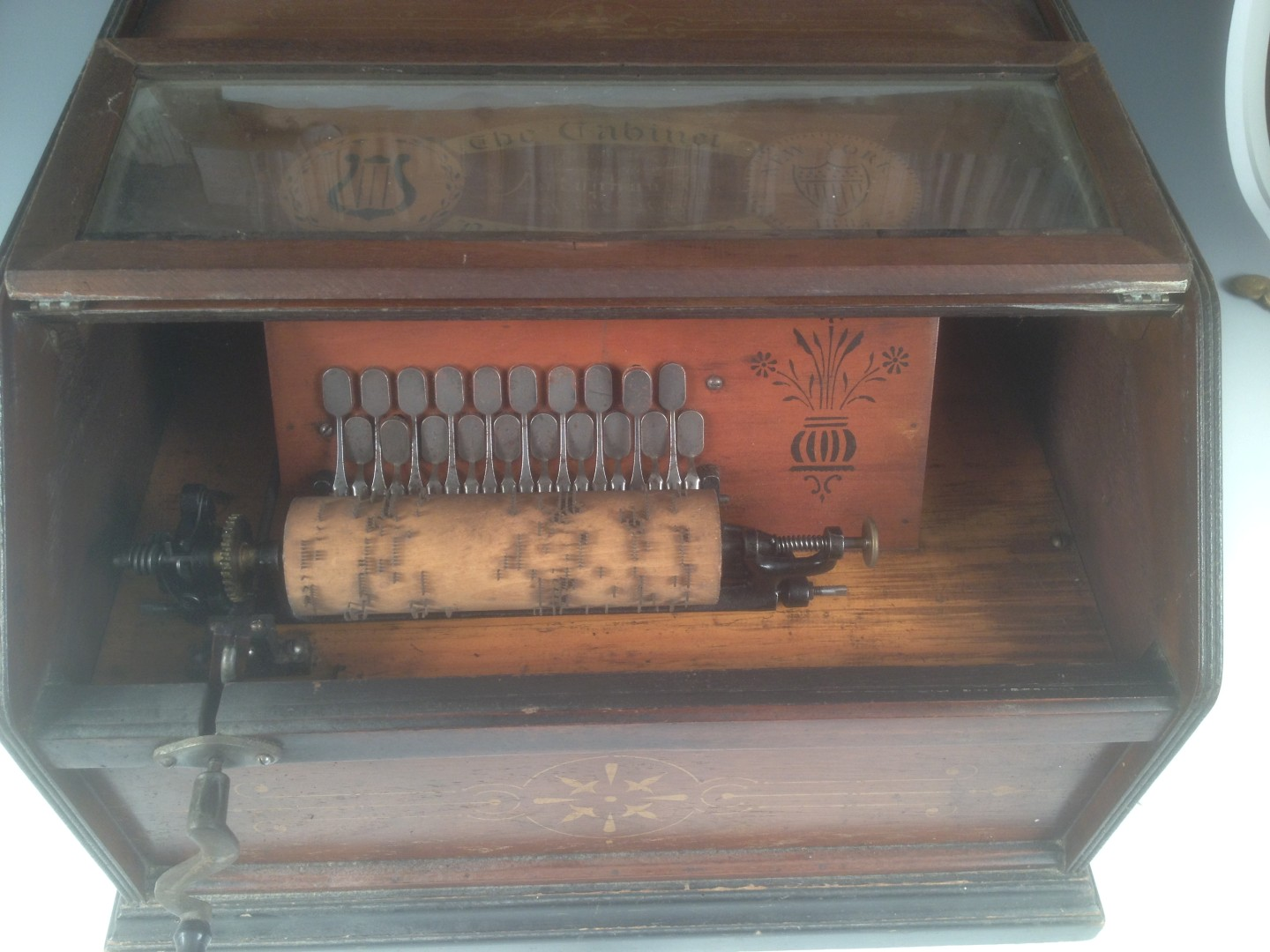 Lot 670 - The Cabinet Roller Organ' by 'Autophone, Ithaca, NY' and seventeen wooden cylinders, the rectangular