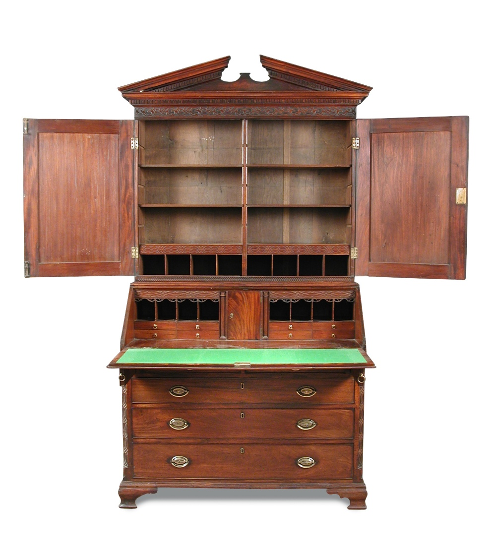 Lot 766 - A George III mahogany bureau bookcase, circa 1770 with breakarch pediment, dentil cornice with blind