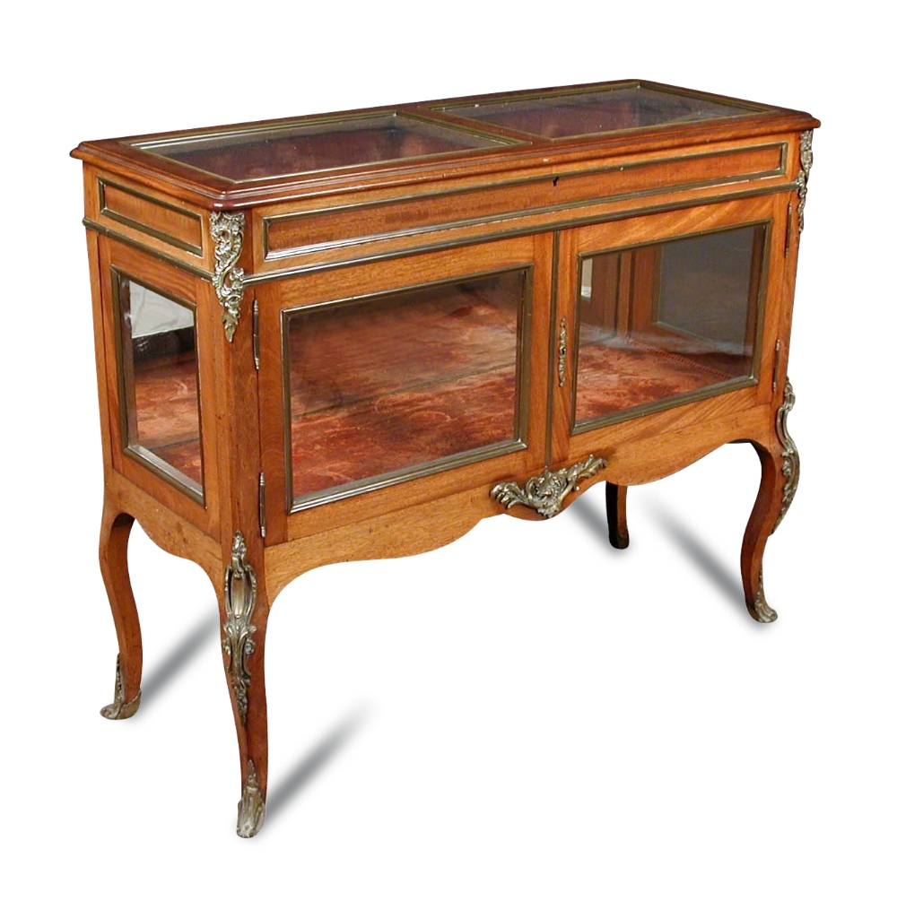 Lot 819 - A French Transitional style mahogany and gilt mounted vitrine, circa 1900, the hinged glazed top