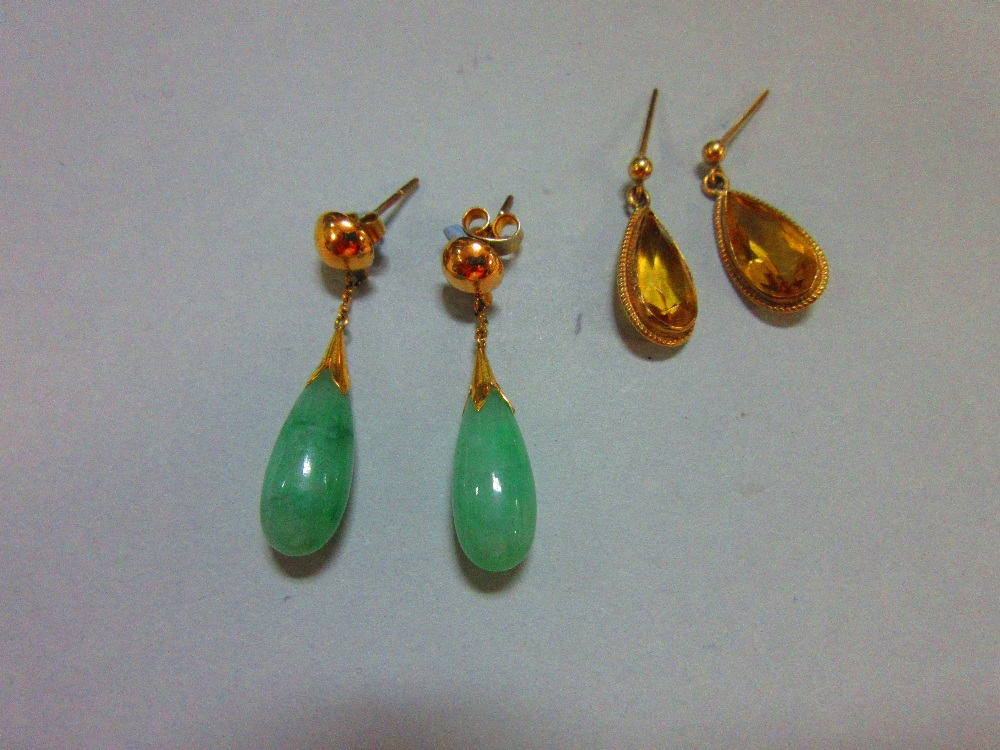 Lot 206 - A pair of jade drop earpendants (with 1975 insurance assessment from Liberty) together with a pair