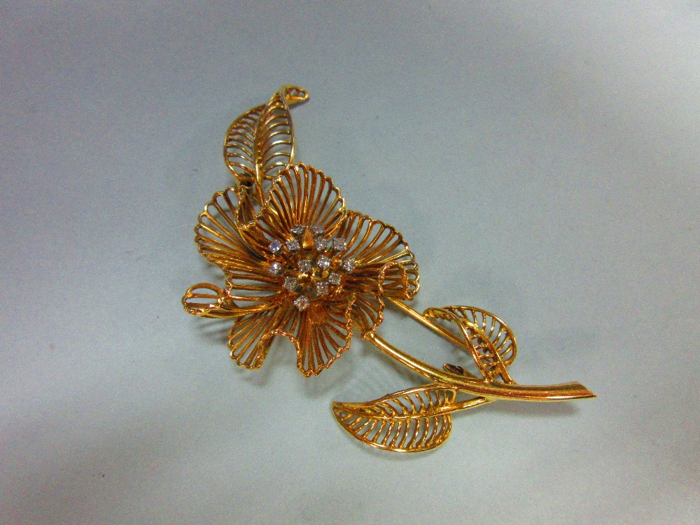 Lot 153 - A mid-20th century diamond set flower brooch, of open wirework structure with three curled leaves
