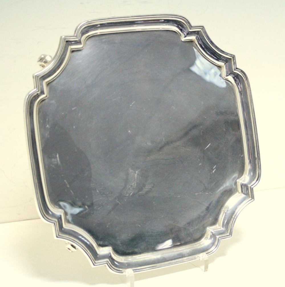 Lot 317 - A silver salver, by the Adie Brothers, Birmingham 1939, square with shaped canted corners and