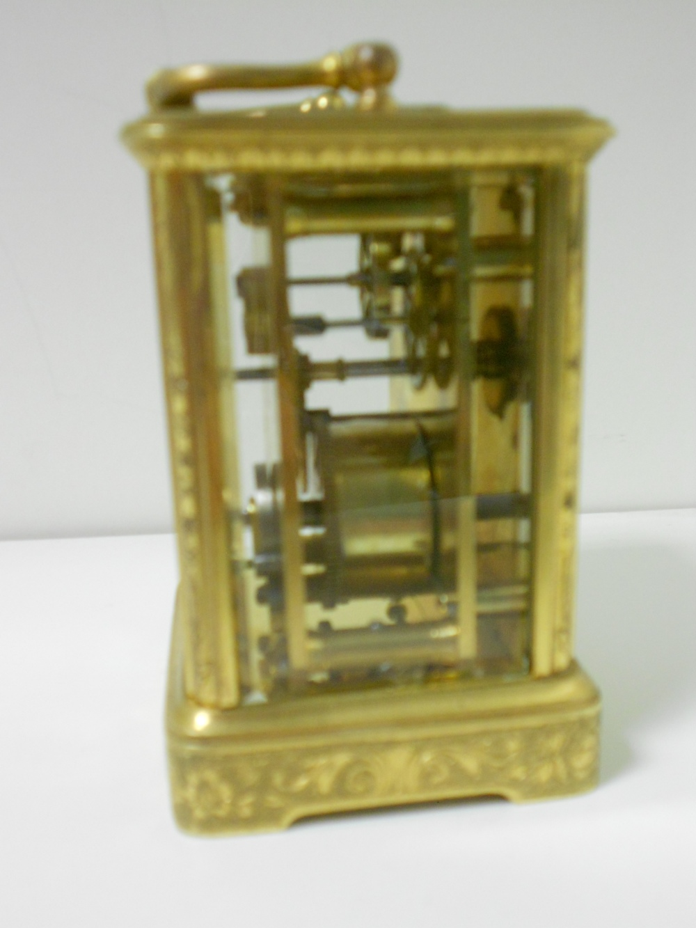 Lot 675 - A small French gilt brass carriage timepiece, with floral scroll engraved case and 4.5cm rectangular
