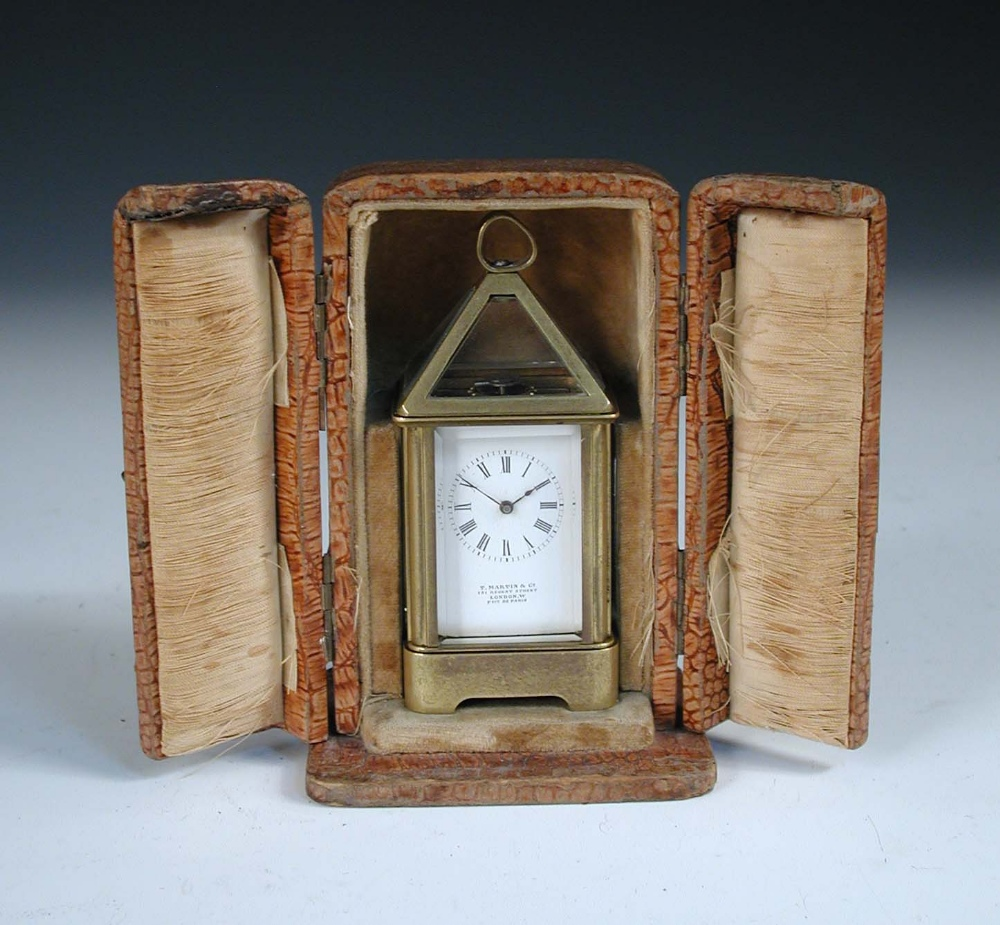 Lot 703 - A French miniature lantern style carriage timepiece, circa 1900, with pyramid glazed top above
