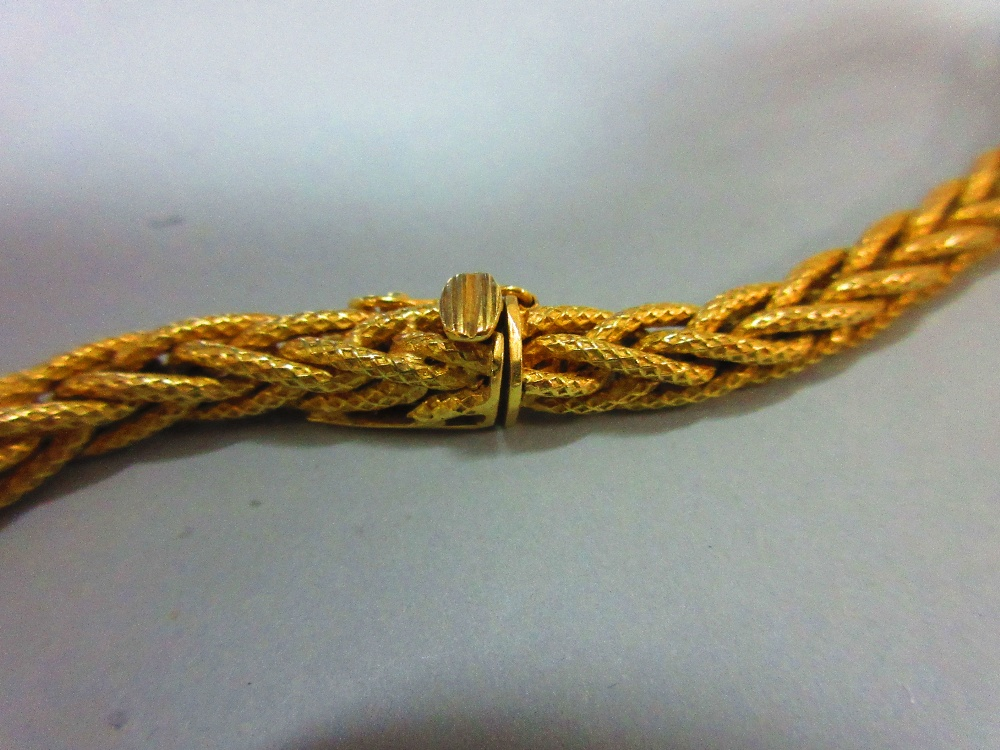 Lot 46 - A substantial foxtail link long chain, stamped '750' for 18ct gold, the supple and textured links to