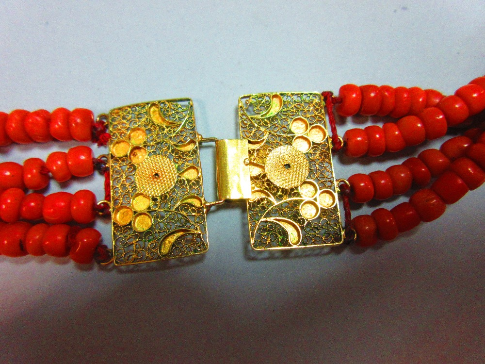 Lot 58 - A period four strand Dutch coral necklace, each strand of approximately uniform tyre shaped beads,