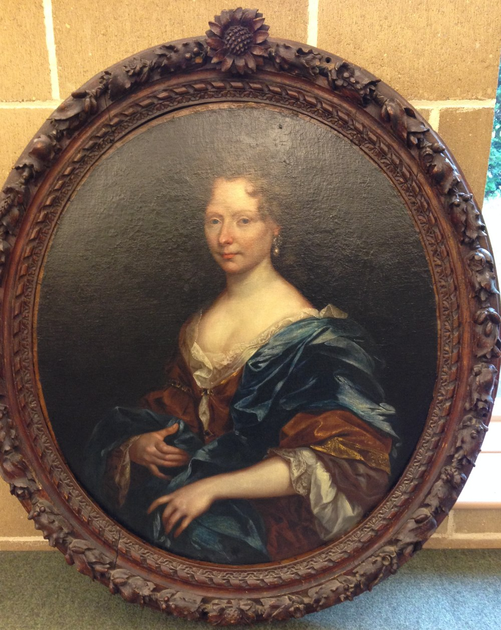 Lot 493 - Circle of William Wissing (Dutch, 1656-1687) Portrait of a lady in a gold dress and blue cloak, with
