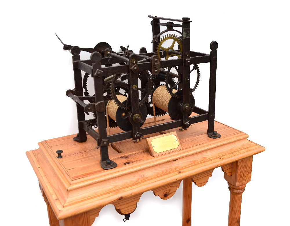 Lot 690 - A late 18th or 19th century iron turret clock, formerly at the Old Priory, St Neots, the twin barrel