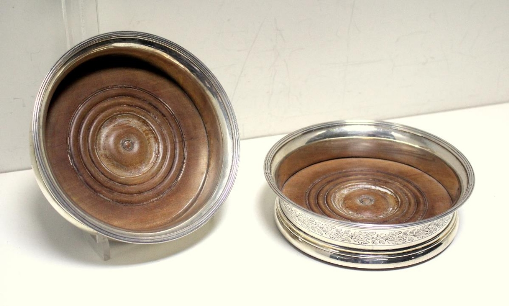 Lot 305 - A pair of George III silver wine coasters, by John Emes, London 1803, each circular with moulded