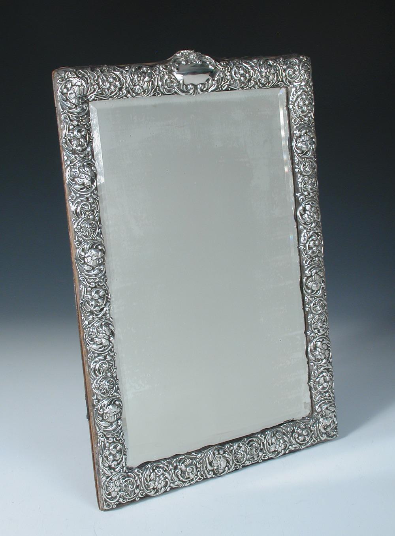 Lot 340 - An Edwardian silver mounted dressing table mirror, by H Matthews, Birmingham 1903, rectangular,