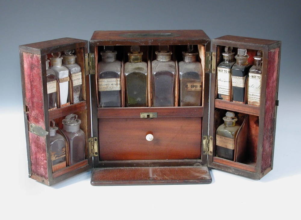Lot 606 - A 19th century mahogany apothecary's chest, the thirteen bottles mainly bearing labels for 'R