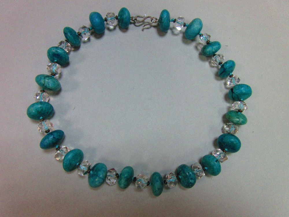 Lot 113 - A rock crytal and turquoise howlite bead necklace, the faceted rock crystal beads alternating with