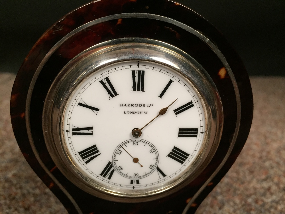 Lot 700 - An Edwardian small size tortoiseshell mantle clock, the balloon shape case with 4.5cm (2in) enamel