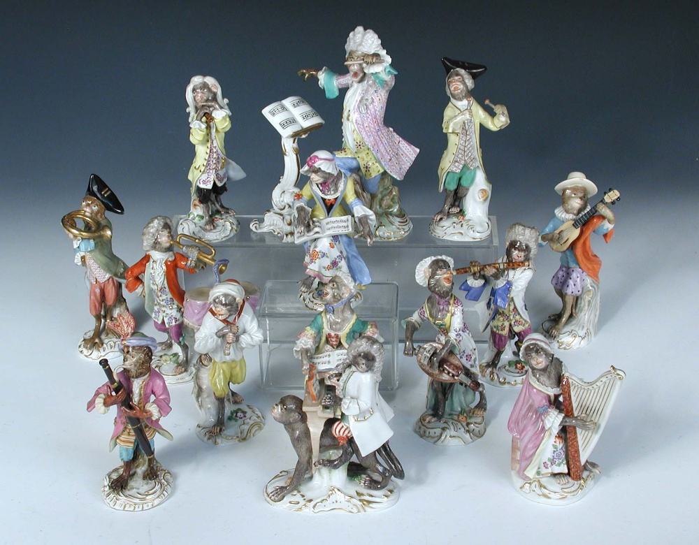 Lot 14 - A Meissen fifteen piece monkey band, each of the figures singing or playing an instrument, a drummer