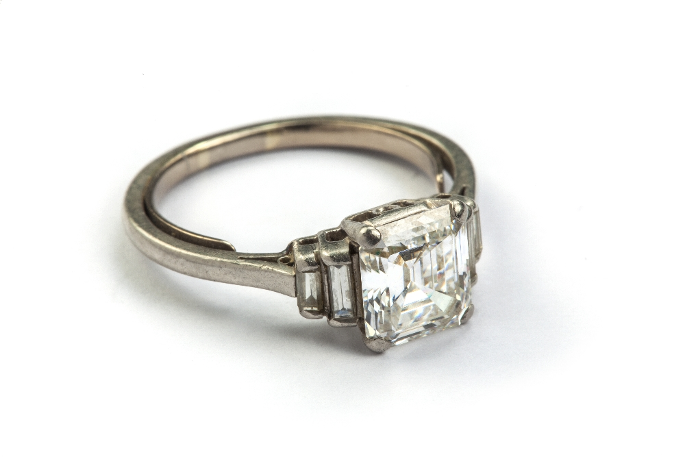 Lot 227 - A diamond ring, the emerald cut principal stone, estimated weight 2.04cts, with two stepped baguette