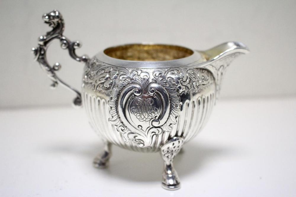 Lot 319 - A Victorian silver three piece teaset, by Charles Stuart Harris, London 1878, the teapot of globular