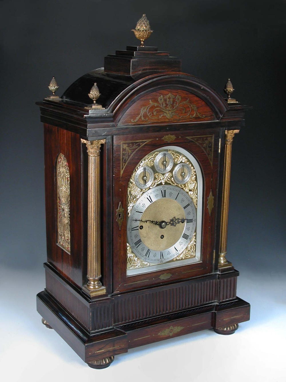 Lot 680 - An imposing Victorian rosewood and brass inlaid chiming clock, the breakarch case with brass