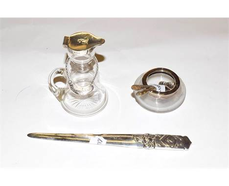 An Edward VII silver paper knife with arms of the Cordwainers' Company, Sheffield 1903, a whisky noggin, Birmingham 1912 with