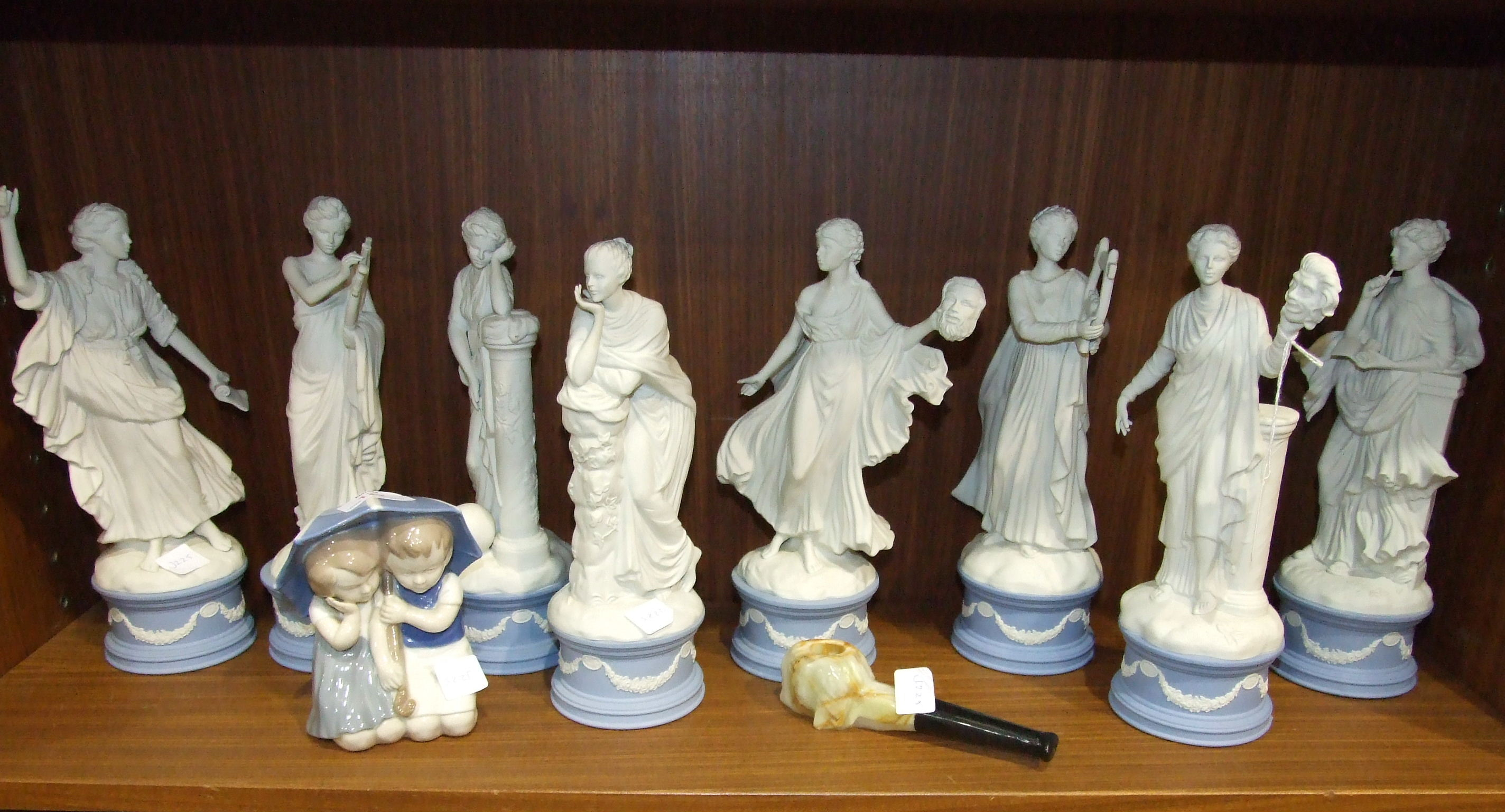 Lot 122 - Eight figurines from the Wedgwood The Classical Muses Collection: Clio (af), Thalia, Melpomene (af),