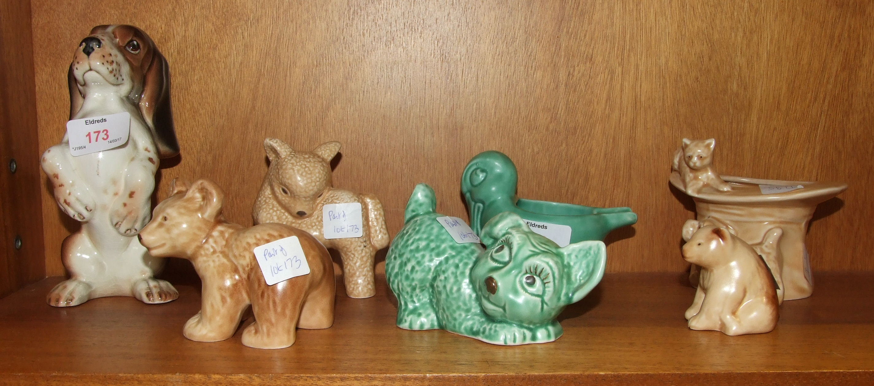 Lot 173 - Seven pieces of SylvaC, including a top hat with cat and dog, 1484, a green glaze crouching dog,