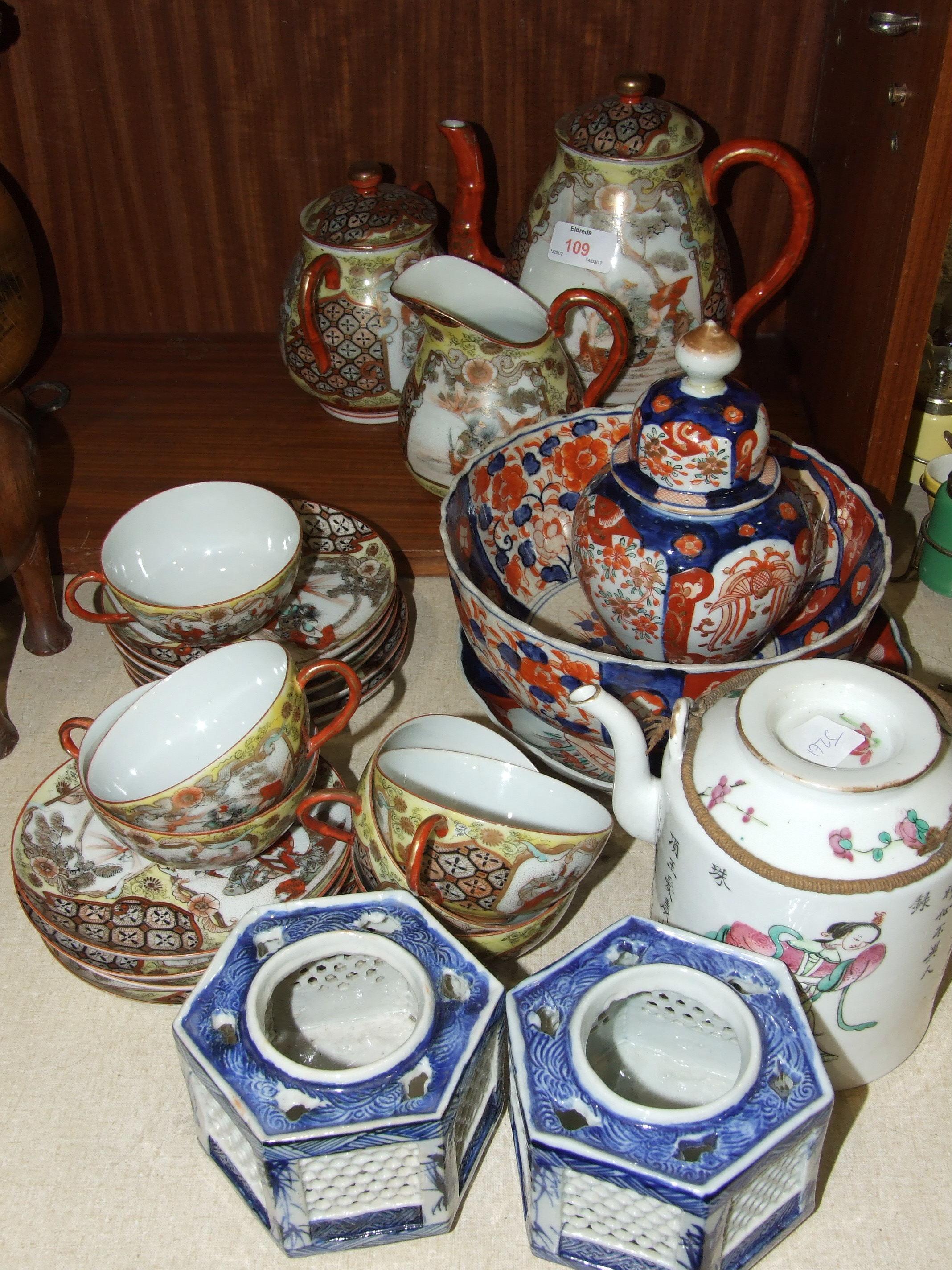 Lot 109 - Eighteen pieces of oriental export tea ware decorated with figures, an Imari plate, 21cm diameter, a