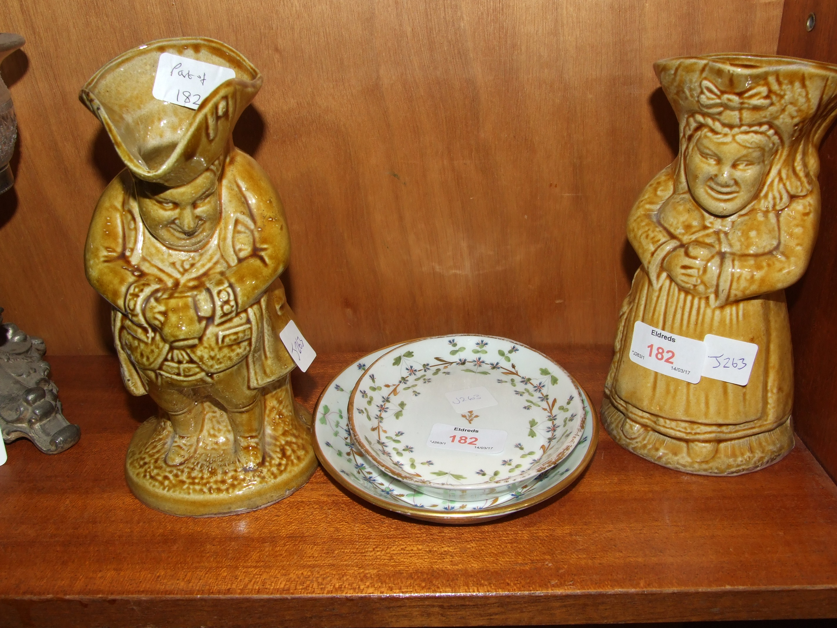 Lot 182 - Two salt glaze Toby jugs, 20cm high and two English ceramic oval trays with floral decoration, 17