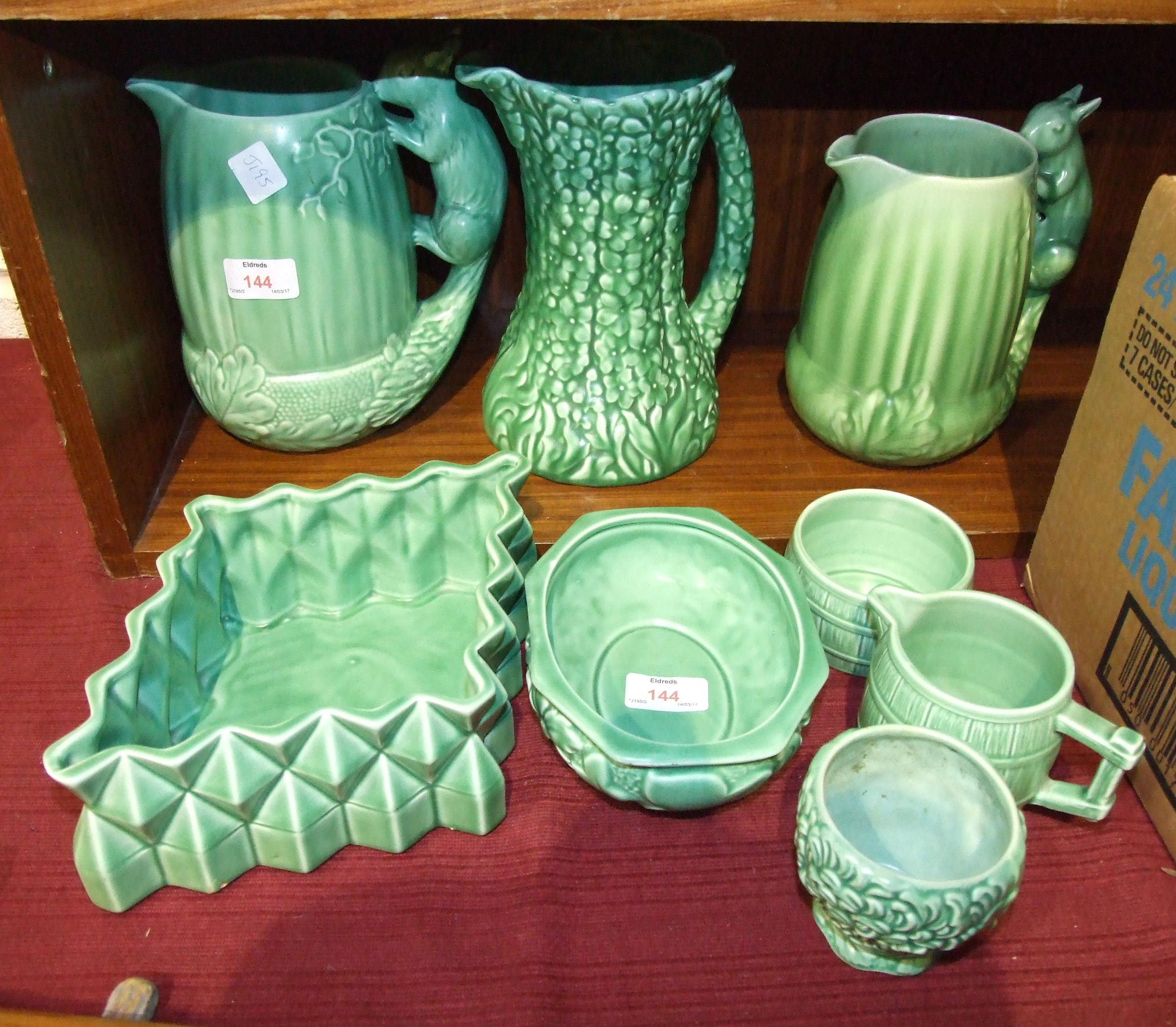 Lot 144 - A SylvaC acorn jug with squirrel handle, no.1959, (ear restored), a similar smaller jug, no.1958,