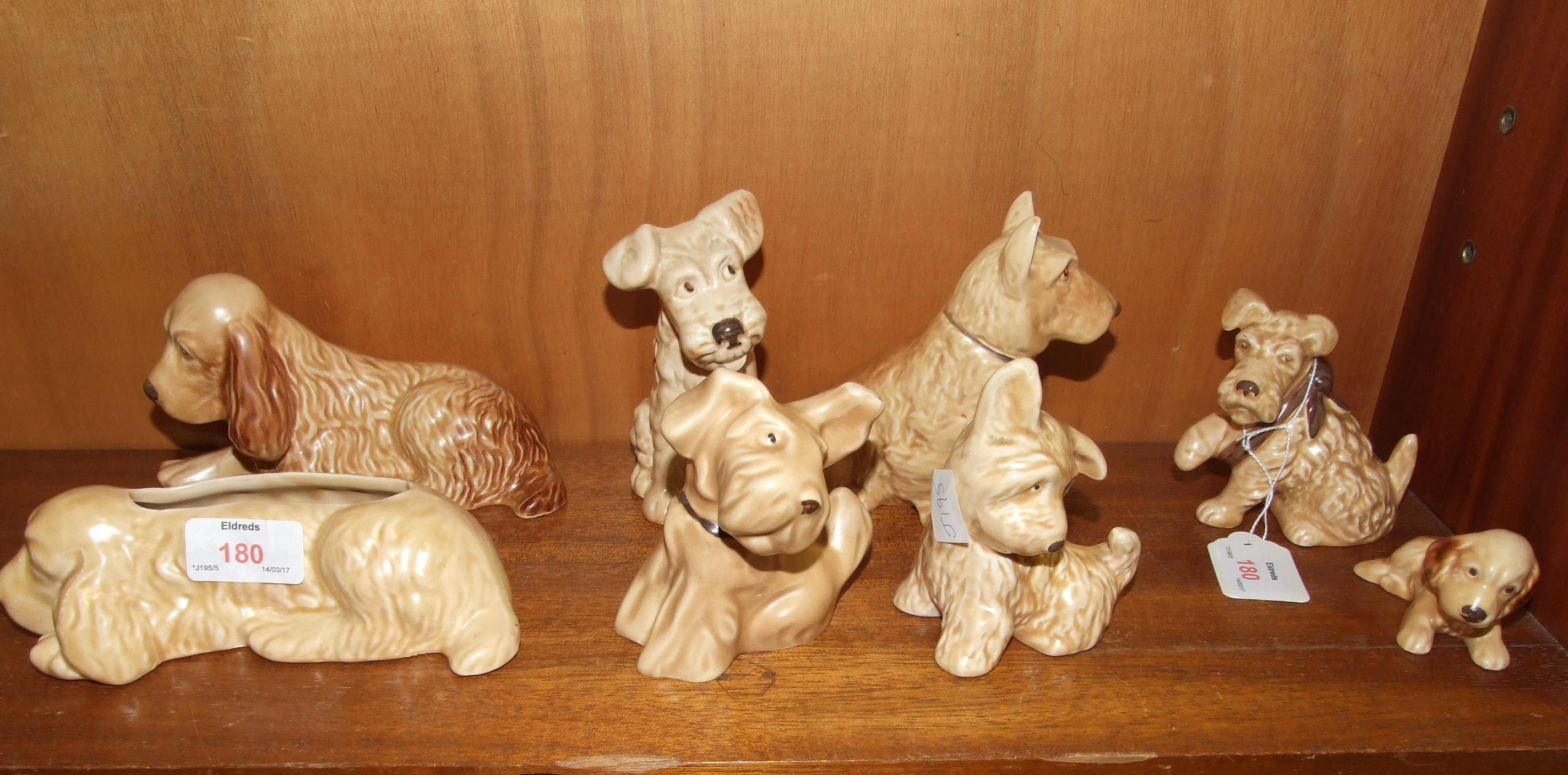 Lot 180 - Eight beige glazed SylvaC dog ornaments, no.s: 2025, 114 (af), 1119, 1378, 1205, 73, 116, 1433, (