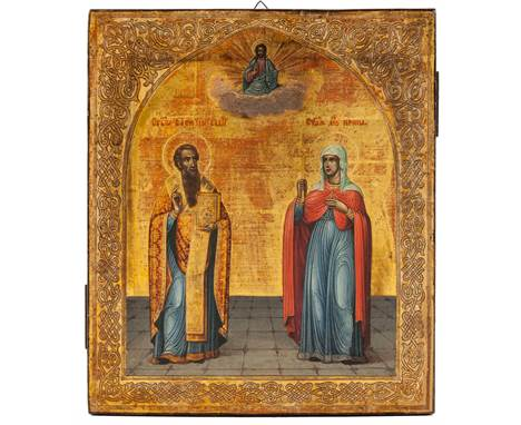 Saint Basil the Great standing with his right hand raised, his left holding a jewel encrusted bible, dressed in a blue robe w