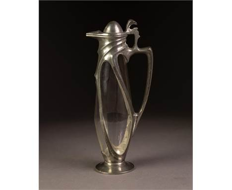 W.M.F STYLE ART NOUVEAU PEWTER MOUNTED SMALL GLASS CARAFE, of slender ovoid footed form with angular scroll handle, domed, hi