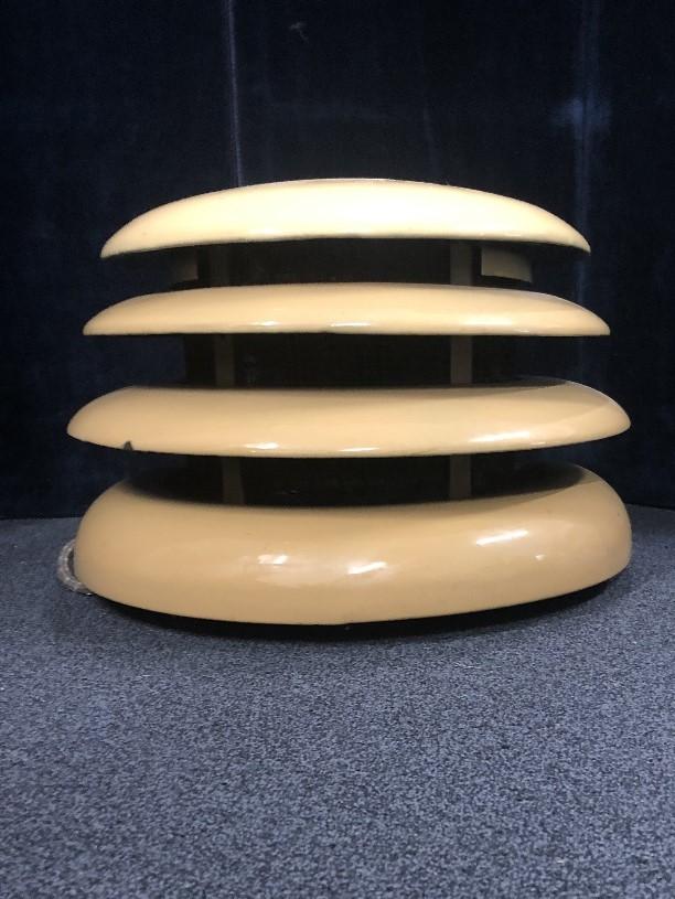 """Lot 4 - An Art Deco HMV """"Beehive enamel room heater."""