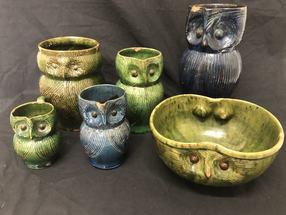 Lot 31 - A collection of owl jugs and an owl bowl by Farnham Pottery.