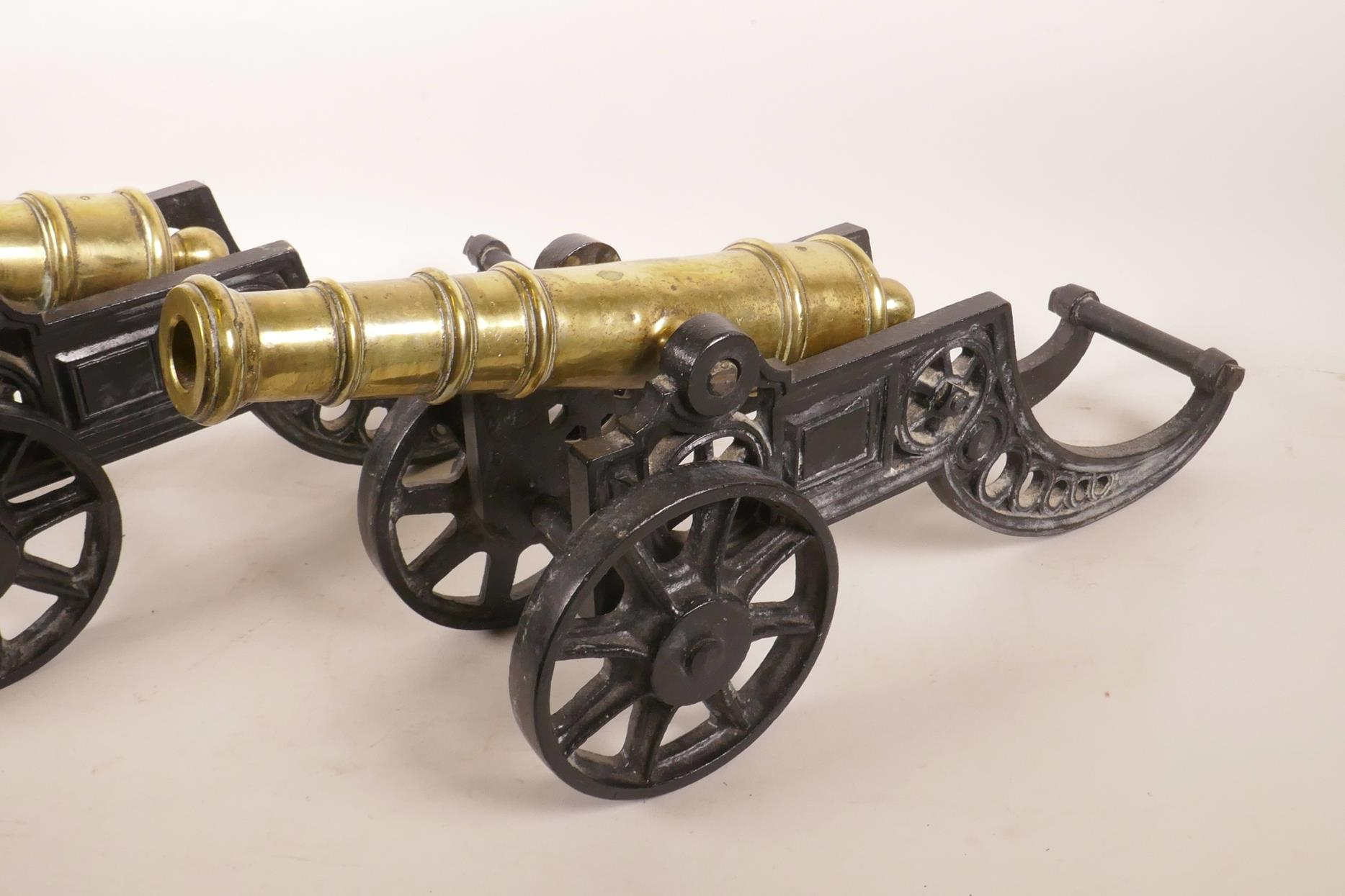 """Lot 27 - A pair of Victorian brass table cannons, 17½"""" long"""