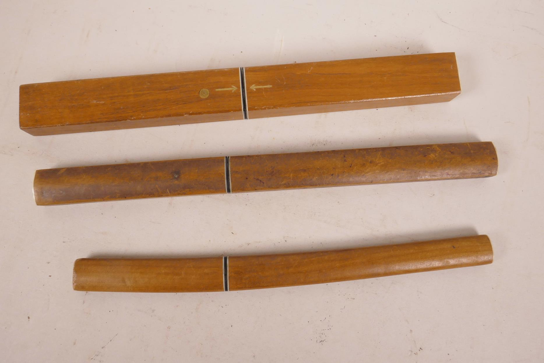 "Lot 19 - Three Japanese floating wood and steel fish knives, longest 10½"""