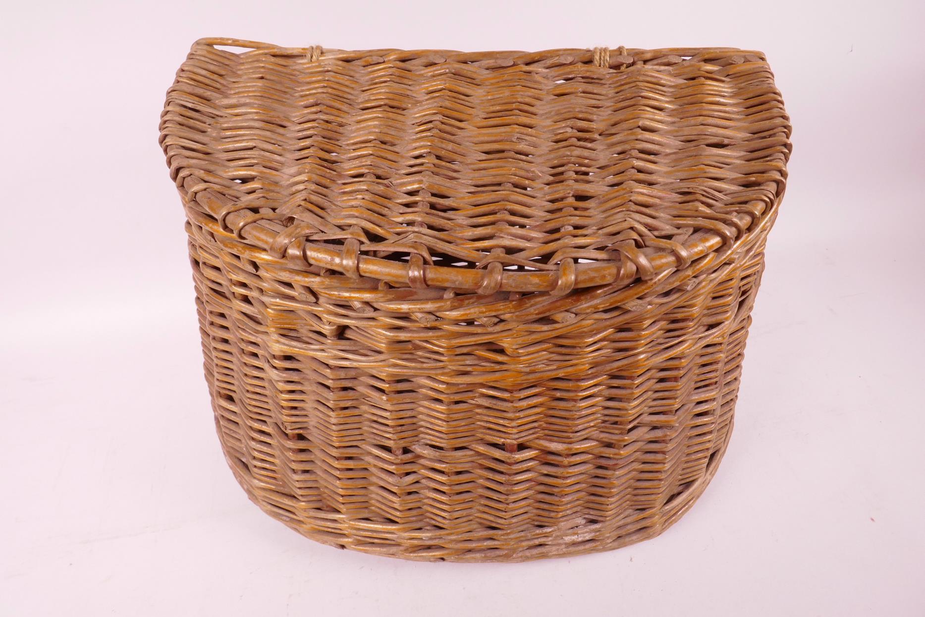 "Lot 24 - A vintage woven fishing basket/creel, 13"" wide"