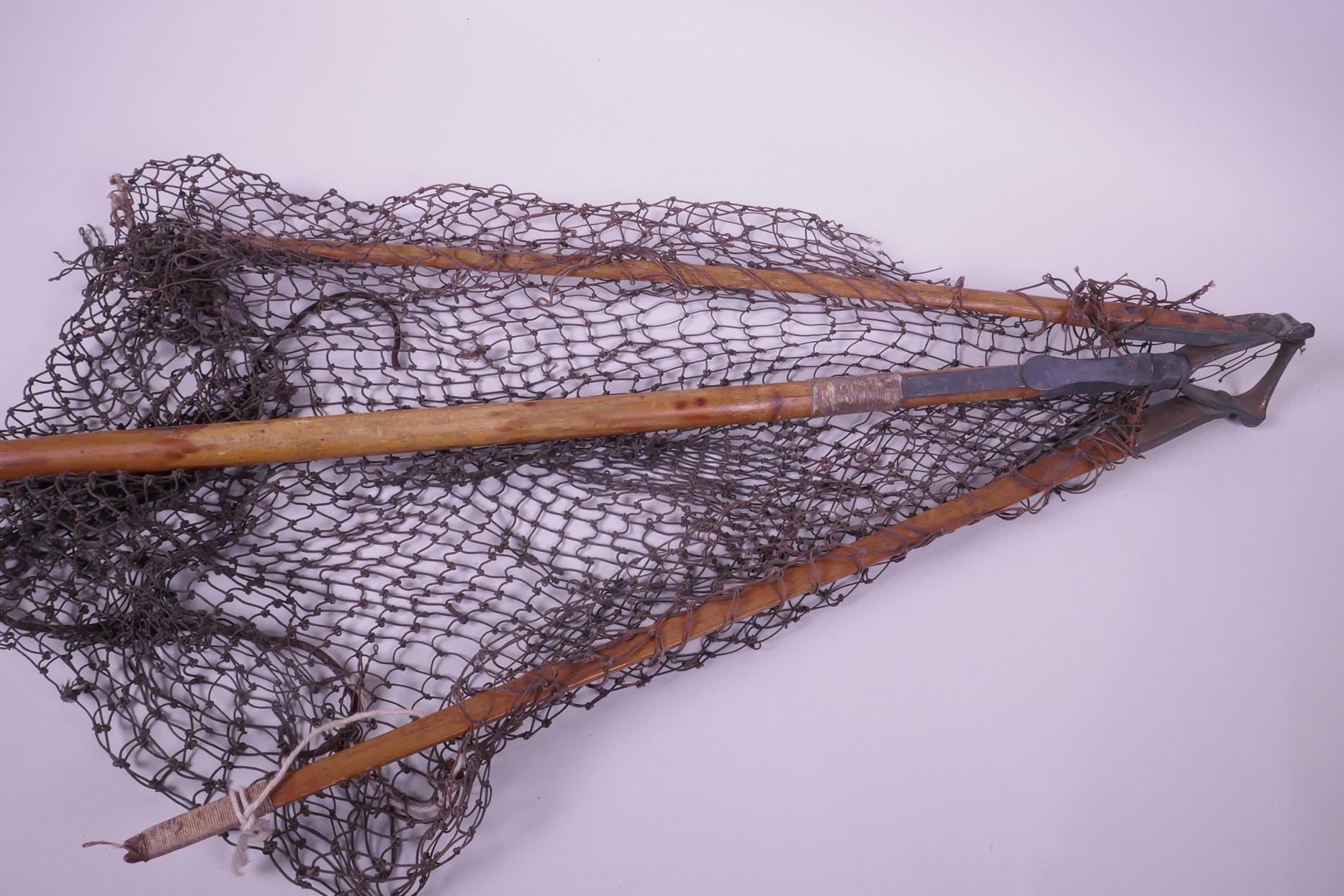 "Lot 35 - A vintage Hardy Bros. bamboo and brass folding landing net, net A/F, 48"" long"