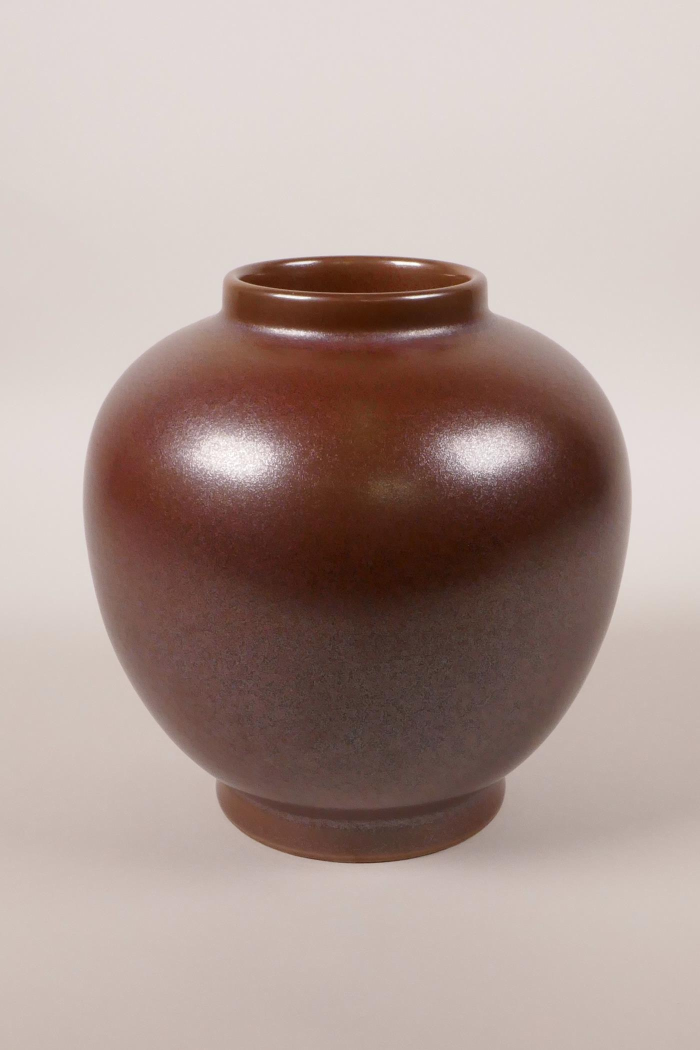"Lot 18 - A Chinese iridescent copper glazed porcelain jar, 6 character mark to base, 6"" high"