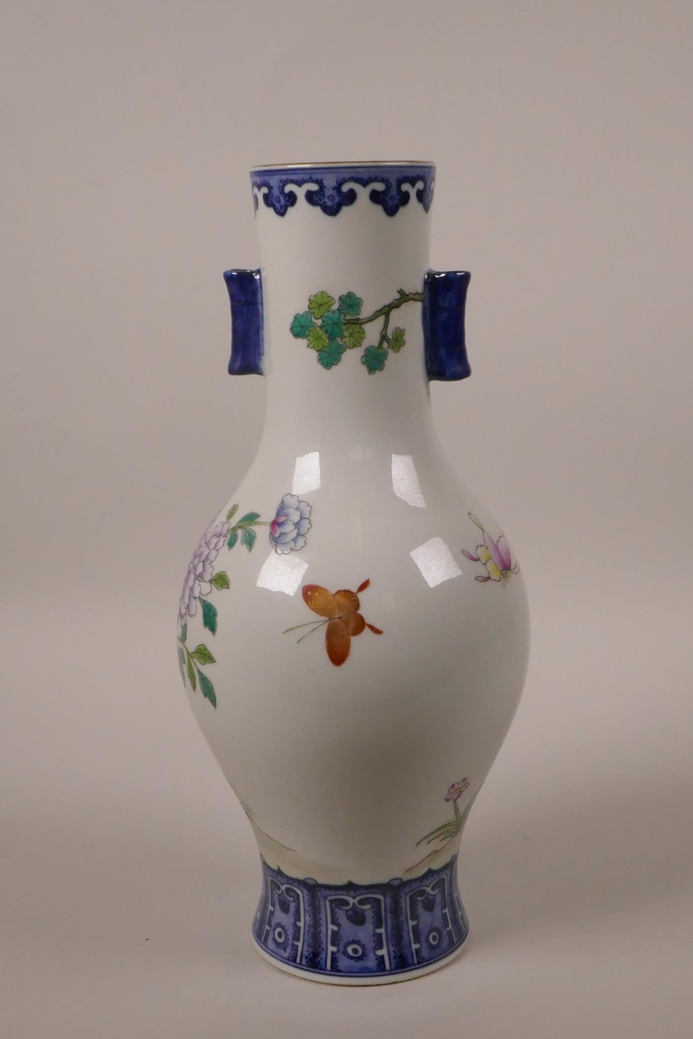 Lot 33 - A Chinese polychrome porcelain vase with two lug handles, decorated with Asiatic birds and