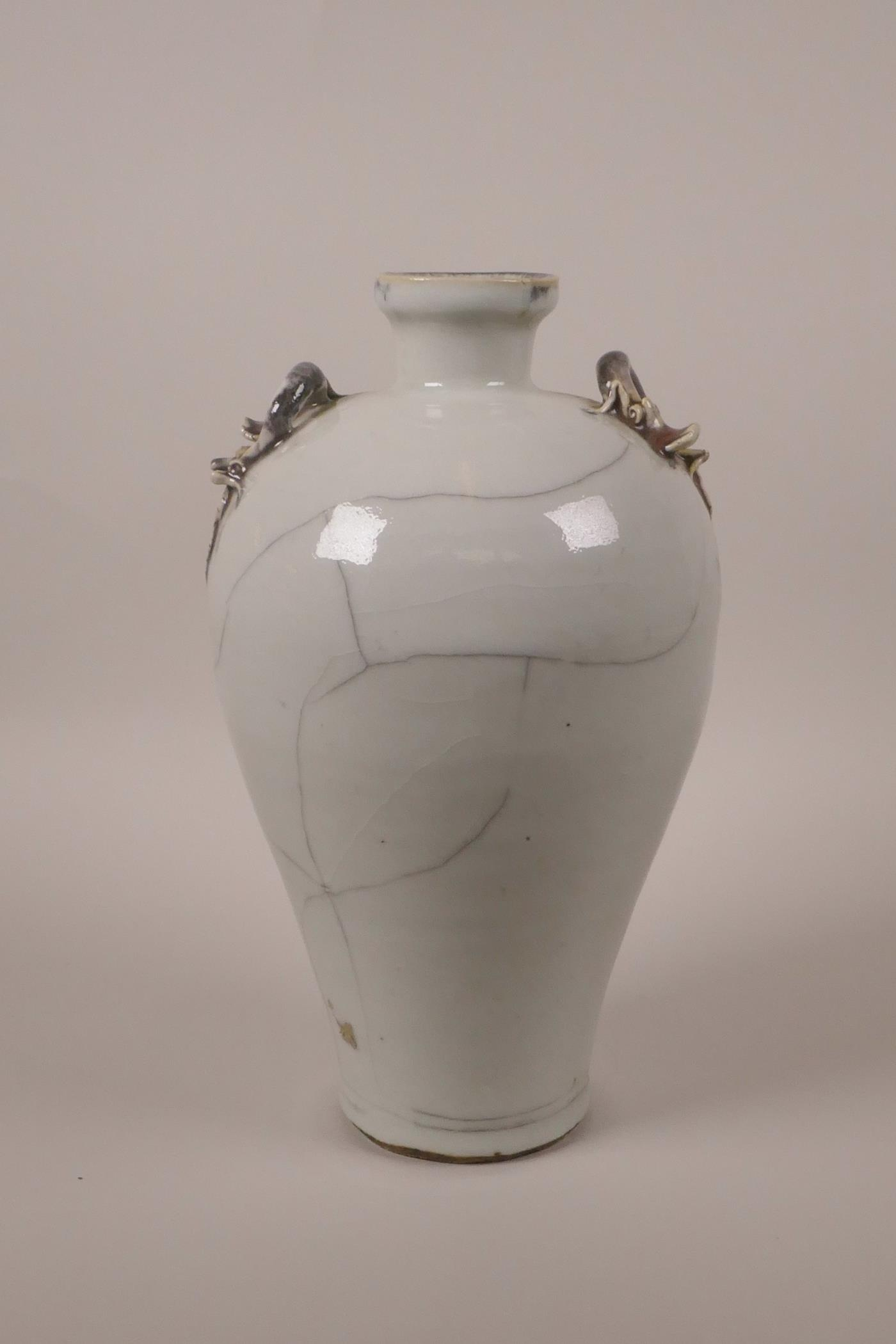 "Lot 28 - A Chinese crackle glazed pottery vase with two dragon handles, 9½"" high"