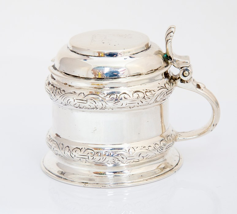 A George III London silver mustard pot and cover, cylinder shaped with raised scrolling border