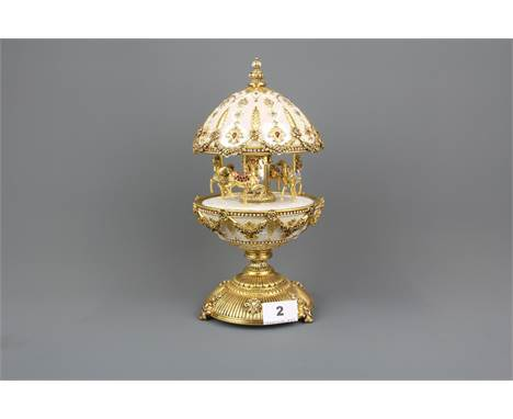 A Faberge inspired Imperial carousel egg by 'The house of Faberge' encrusted with Swarovski crystal, H.29cm.
