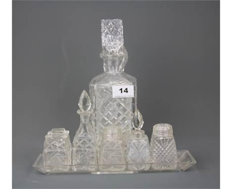 A cut crystal decanter together with a cut crystal cruet, decanter H. 24.5cm.