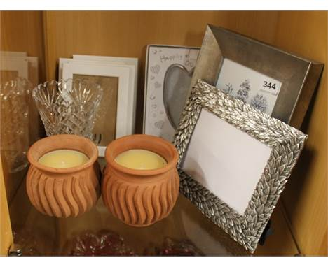 A pair of incense perfumed candles, a cut glass vase and a quantity of contemporary photo frames.