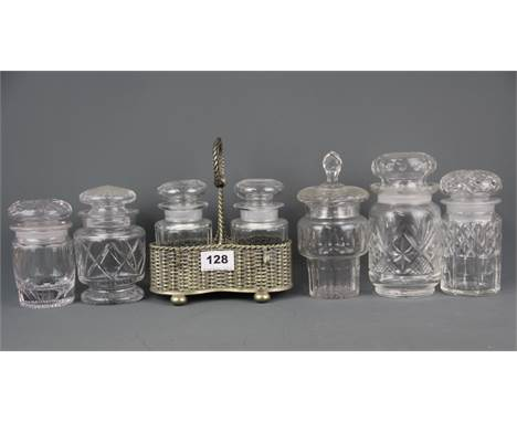 A group of seven cut glass pickle jars and a silver plated stand, tallest 18cm.