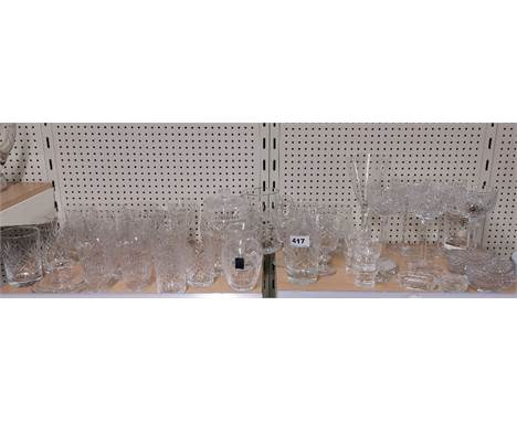 A set of cut glass wine glasses together with a quantity of other glass.