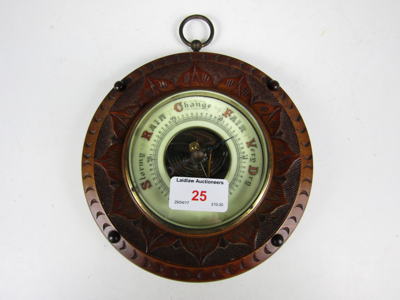 Lot 25 - A late 19th Century carved mahogany circular barometer