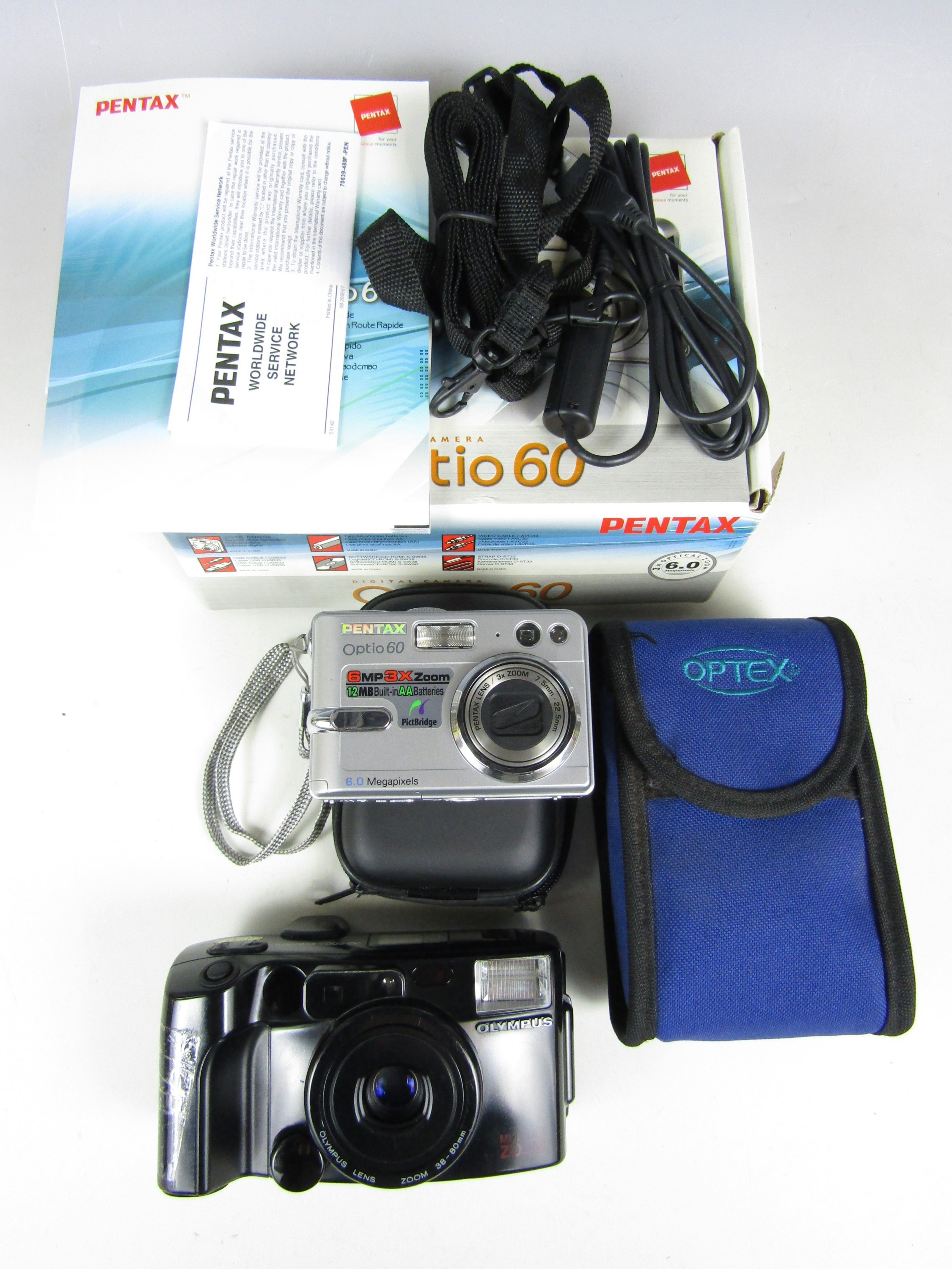 Lot 59 - A Pentax Optio 60 digital camera together with an Olympus multi zoom camera