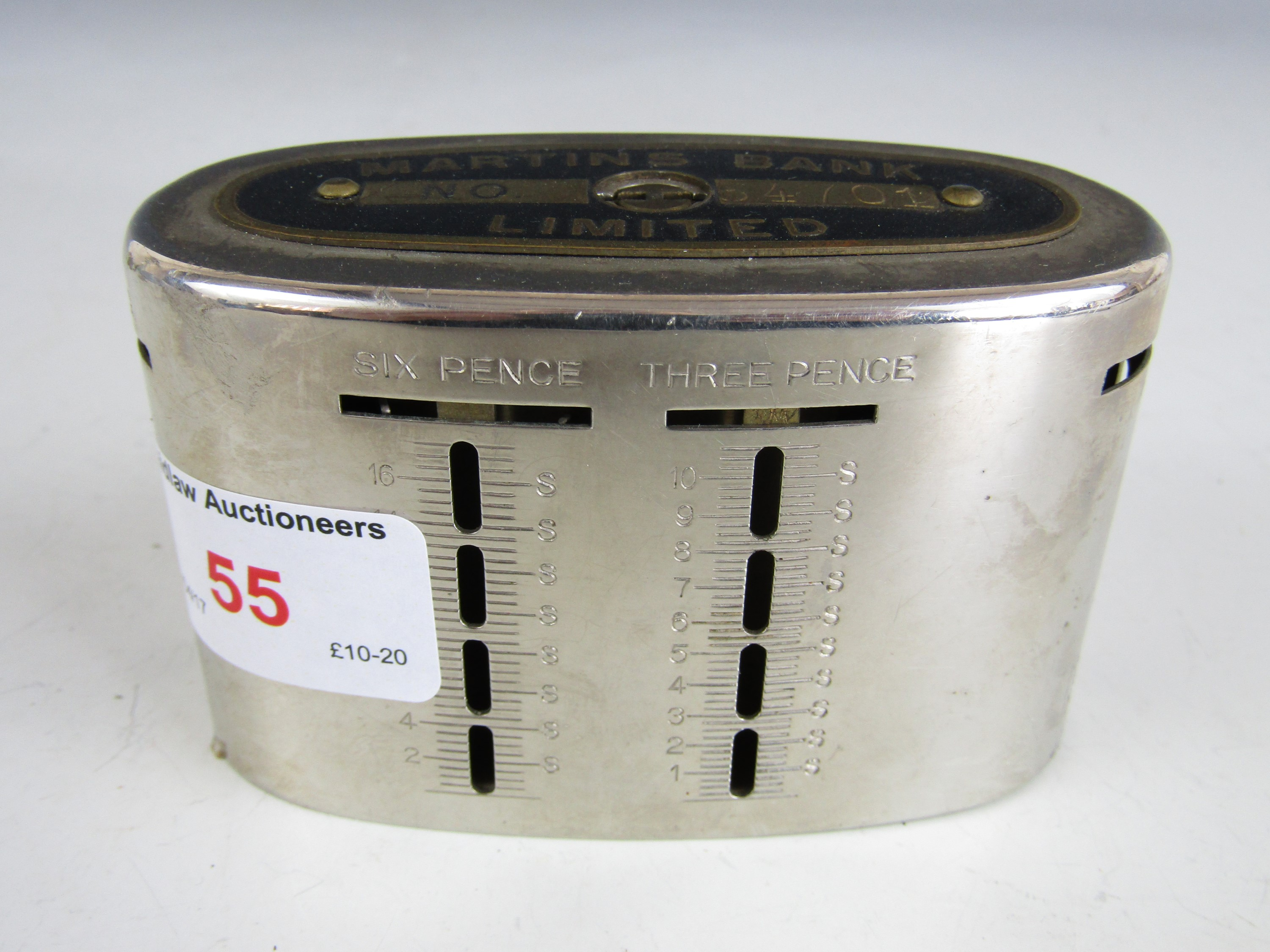 Lot 55 - A Martins Bank Limited money box with key