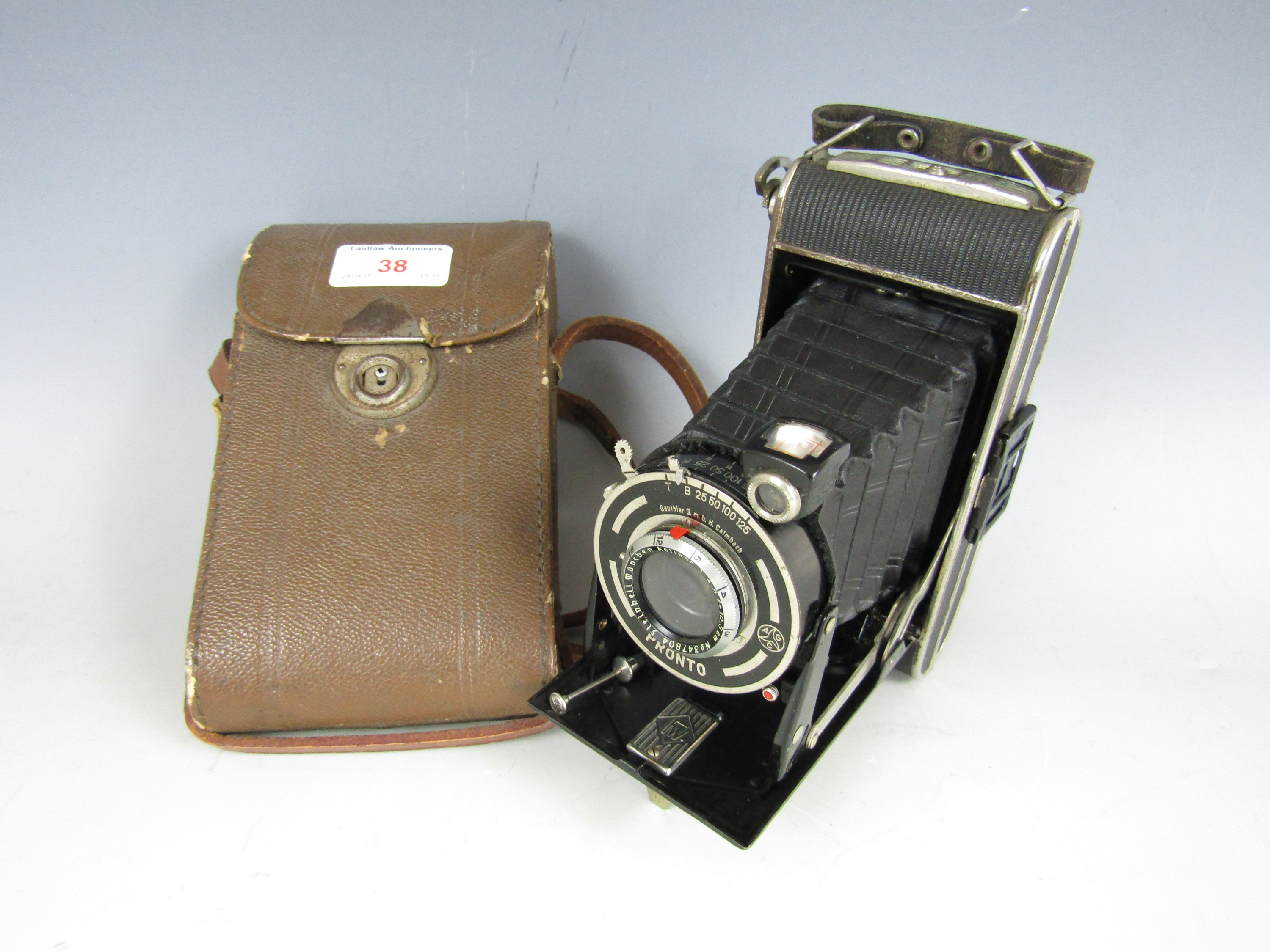Lot 38 - A vintage FW Pronto folding roll-film camera with case