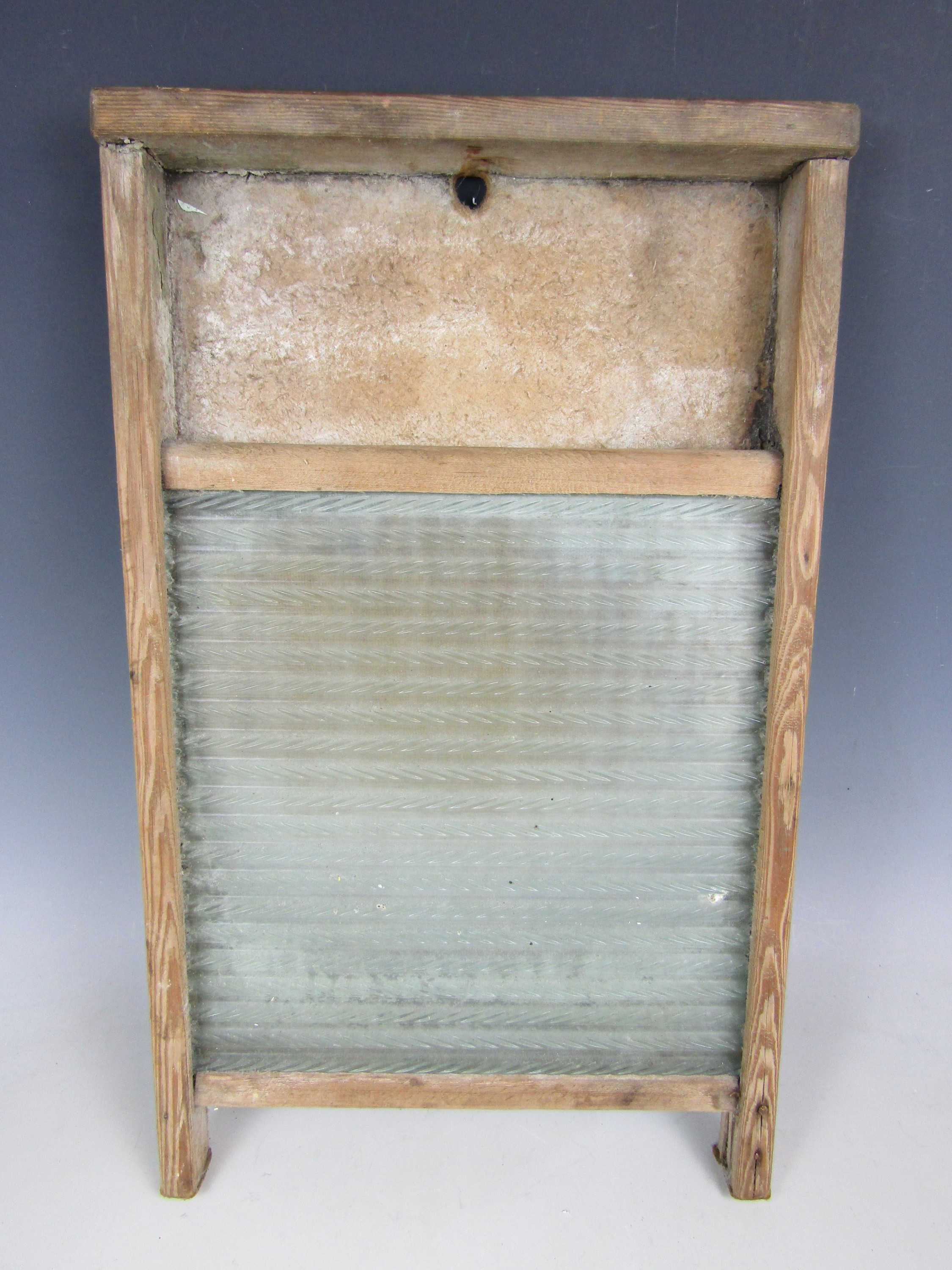 Lot 45 - An antique washboard